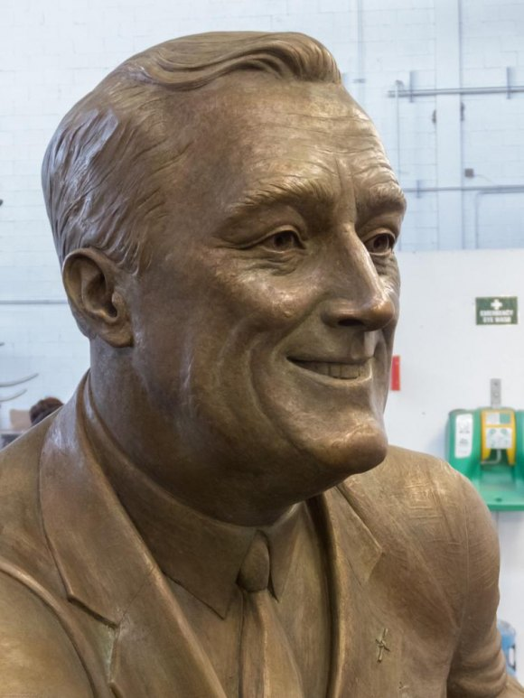 FDR's smile radiates as he turns to greet the visitor.