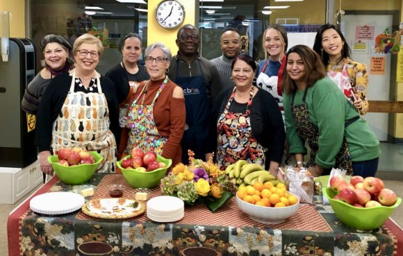 The Team readying the feast: (from left) Lisa Fernandez (CBN), Judy Berdy, Delores, Wendy Hersh,   Amadou Keita, Enoch Atkins, Pat Rivera, Mallory Jensen, Debbie, Jiyoung Choi (CBN)