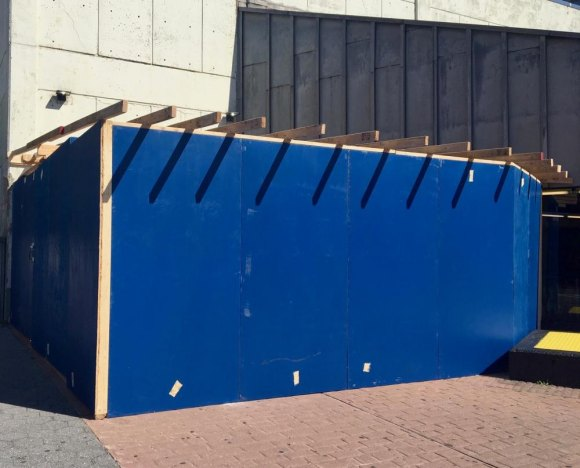 Boxy blue shed is ugly, but give the MTA credit for covering up an uglier feature.