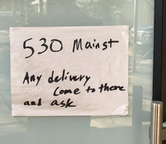 A sign posted on 503's doors sends deliveries to Wholesome Factory, another Nasser business.
