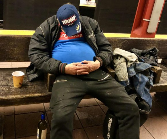 Saturday, 1:00 P.M., a Trump supporter takes a break from the endless campaign in the 34th Street Subway Station.