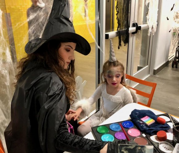 When dressing up as a fairytale unicorn just isn't enough... face-painting by a good witch.