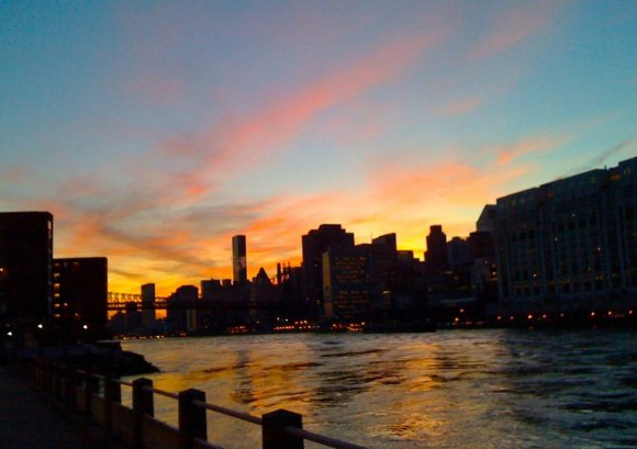 Among Roosevelt Island's many free assets, fiery sunsets along the Manhattan skyline.