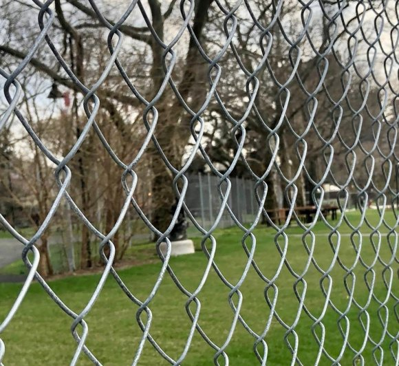 Metal fencing around DEP's emergency access road prevents access for picnics but may soon be coming down, according to RIOC.