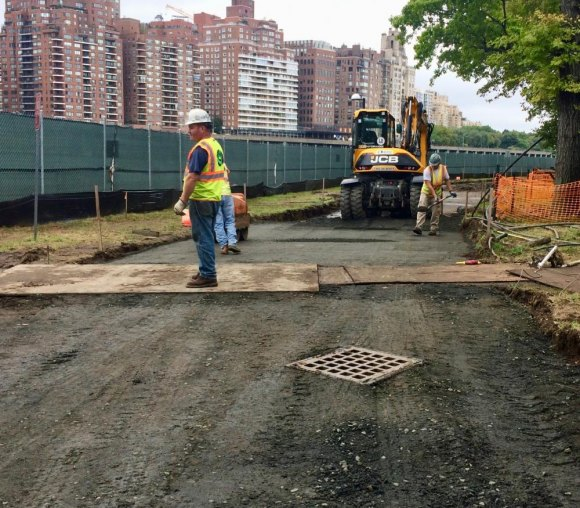 Surface soil was removed to provide a reliable base for the grass-paved road.