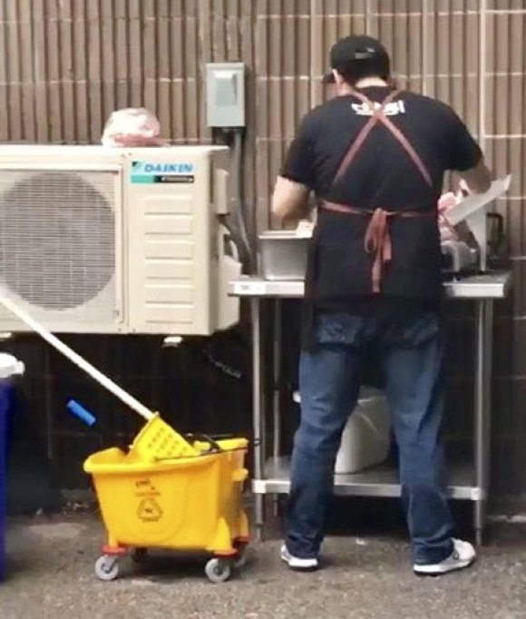 In June, we reported on Liukoushui caught preparing meat outdoors during a rain shower, adjacent to janitorial storage under a main building exhaust hood.