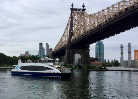 As dawn brightened the skies, the first NYC Ferry made its way to Roosevelt Island, last summer.