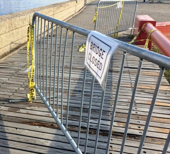 Visitors simply shove RIOC's useless fences aside, leaving yellow tape flapping in the breeze.