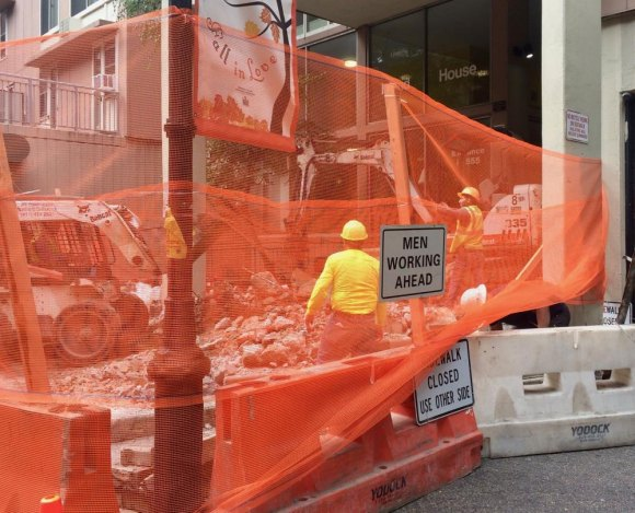 Orange construction fencing steers pedestrians one last time around Island House's dreaded entrance steps.