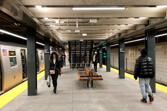 The lower, active platform abandons art for greater safety and more seating, welcome additions for midtown travelers.