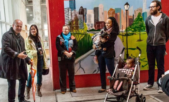 Erica Spencer-EL, second from right, at Motorgate Gallery opening in 2016 with two of her children along for the art.