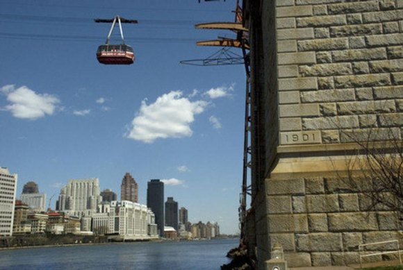 The original Roosevelt Island Tram lifts off toward Manhattan