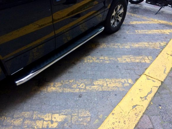 Even parking restriction lines, which carry much less traffic, are badly faded.