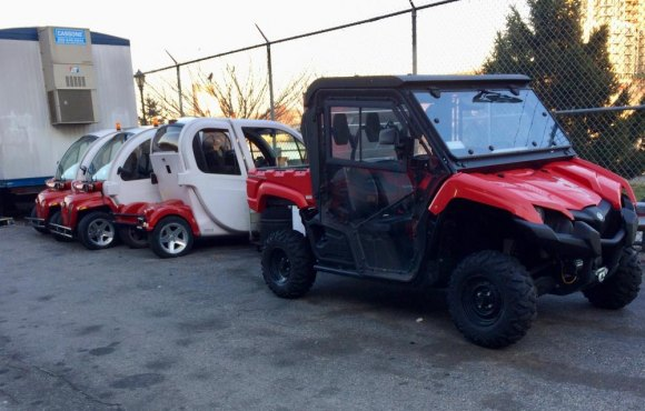 At RIOC, golf carts, four of them parked behind Motorgate, but no golf course.