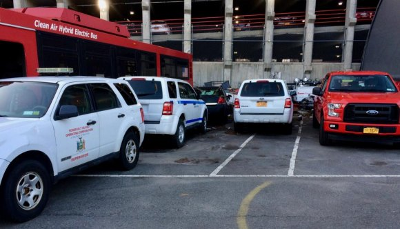 Just how many official vehicles, beside all the PSD cars, does a two-mile long island need?
