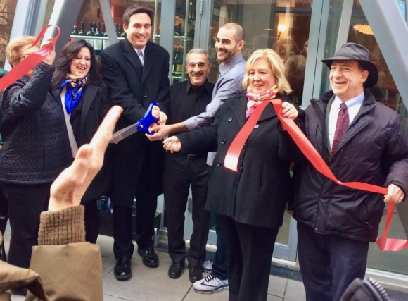 Ribbon cutting in December, 2017, when Nisi and its great coffee returned to Main Street.