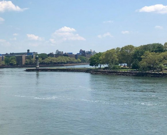 Vintage Roosevelt Island, north end lighthouse stands guard over Hell Gate.