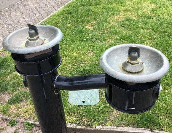 A legacy of last years badly managed contaminated water crisis, water fountains in the park remain dry, a year later.