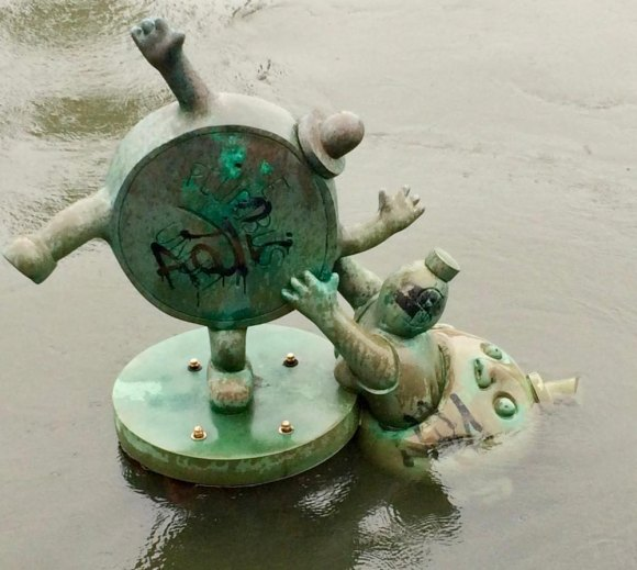 Tom Otterness's graffiti scarred sculpture in the East River.