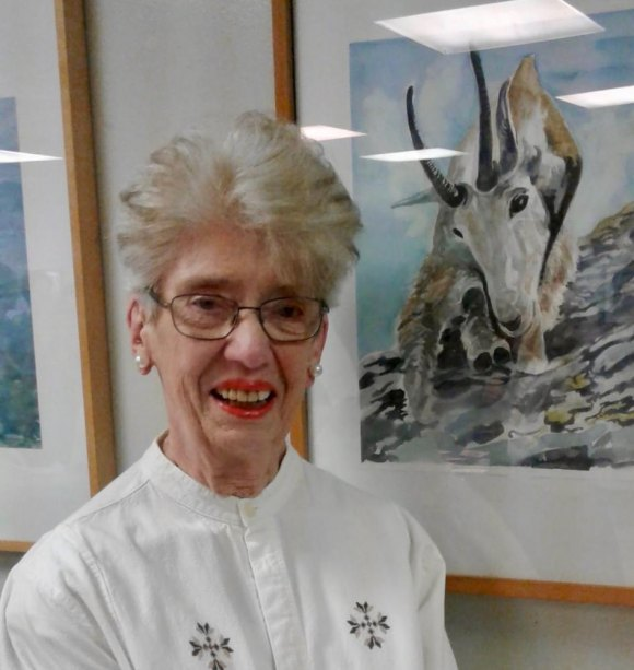 Ursula Beau-Seigneur with her artwork at the CBN/RI Senior Center