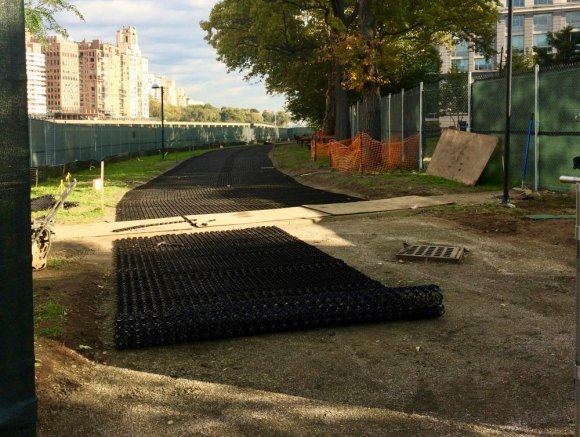 Before turf was applied, a mesh base creates a firm footing for the road.