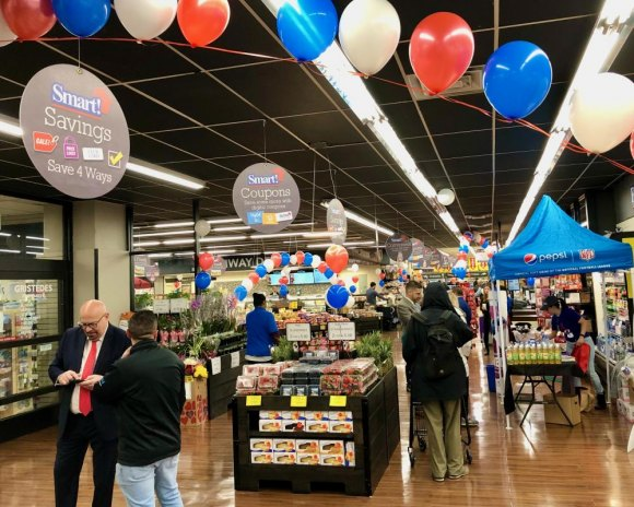 Balloons, giveaways and friendly employees set a welcoming tone on opening day.