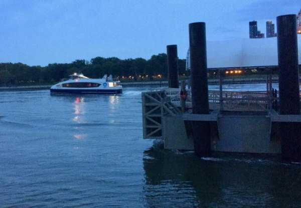 An NYC Ferry travels north toward Astoria where it will pick up passengers for the trip to Roosevelt Island.