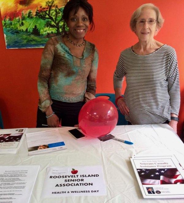 RISA President Barbara Parker (L) in May at CBN/RI Senior Health & Wellness Day