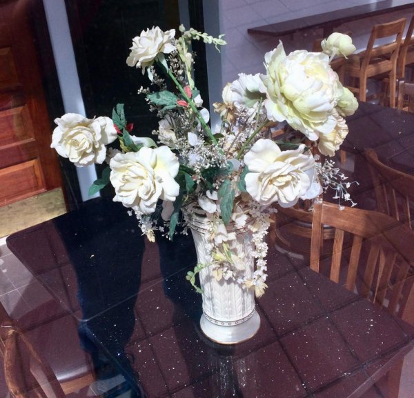 Flowers waited a year for Nisi to welcome guests.