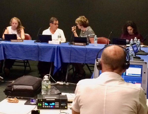 RIOC President Susan Rosenthal confers with Housing & Community Renewal representative Alex Valella