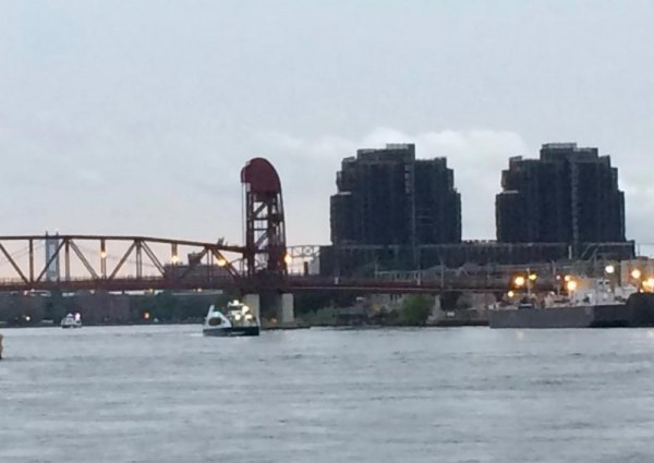 First ferry approaches beneath the Roosevelt Island Bridge.
