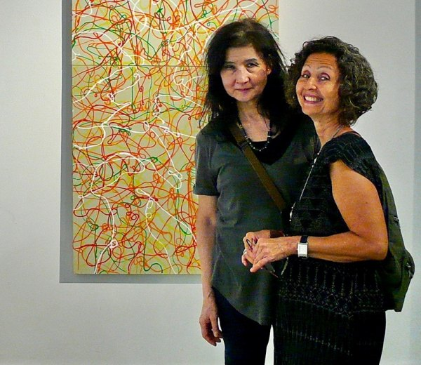 Toshiko Kitano Groner (L) with a painting by Ioan Popoiu.