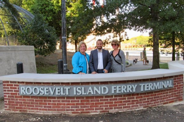Seawright, Serrano and Rosenthal pose at the Roosevelt Island Ferry Landing entrance.