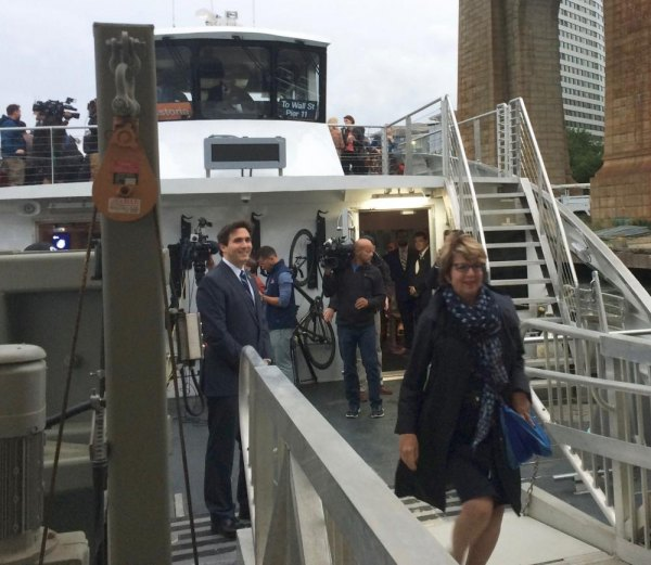 NYC Ferry Opening Day: As Kallos looks on RIOC's Susan Rosenthal becomes the first passenger to arrive for work on Roosevelt Island.