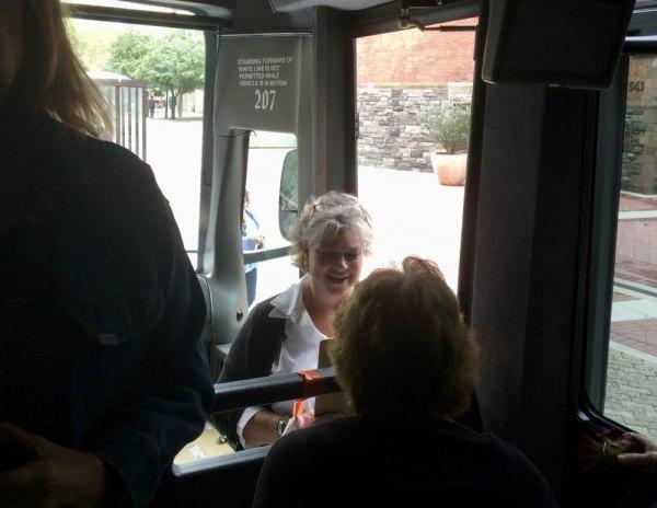 CBN/RI Senior Center Director Lisa Fernandez manages bus loading on Roosevelt Island for a Trip to Belmont Park.
